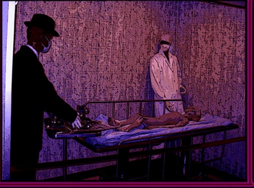 Two men in coats and hats stand over a table with an alien-looking corpse lying on it.