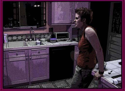 A woman leans against a kitchen counter